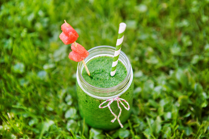 Spinach green smoothie as healthy summer drink, with watermelon hearts